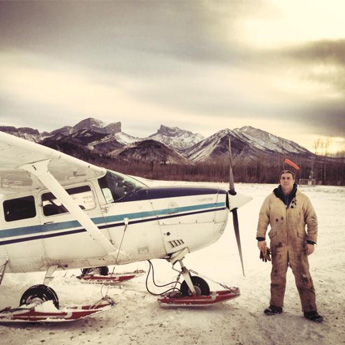 Plane and Aviator On Icy Canadian Landscape